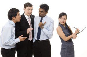 three-businessmen-talk-about-a-female-colleague-behind-her-back